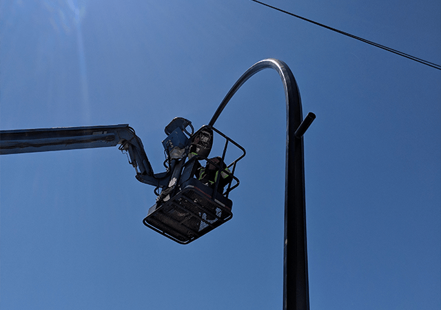 TCA Electric Electrician working on a repairing a street light.